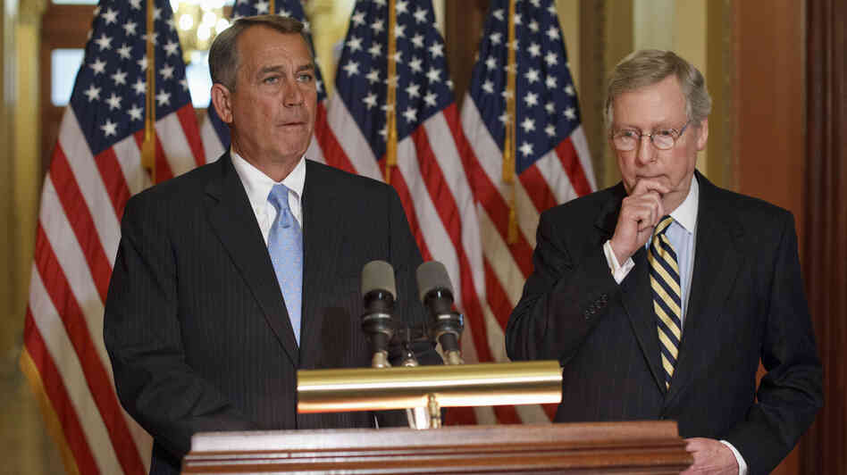 House Speaker John Boehner, R-Ohio (left) and Senate Minority Leader Mitch McConnell, R-Ky., on Capitol Hill in February. Republicans have been quick to criticize the president for bypassing Congress with his immigration action, but they've been unusually silent on the policy itself.