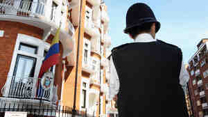 A British police officer stood outside the Ecuadorian consulate in London earlier today, as WikiLeaks founder Julian Assange remained inside.