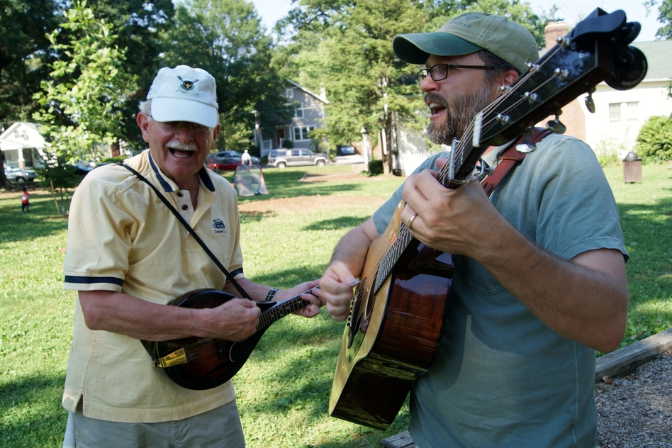 CABOMA members play guitar and mandolin. (NPR)