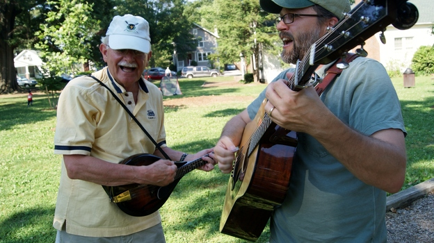 CABOMA members play guitar and mandolin on a summer afternoon. (NPR)