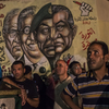 In Cairo's Tahrir Square on Tuesday night, men gathered in front of graffiti showing ousted President Hosni Mubarak and others from his regime.