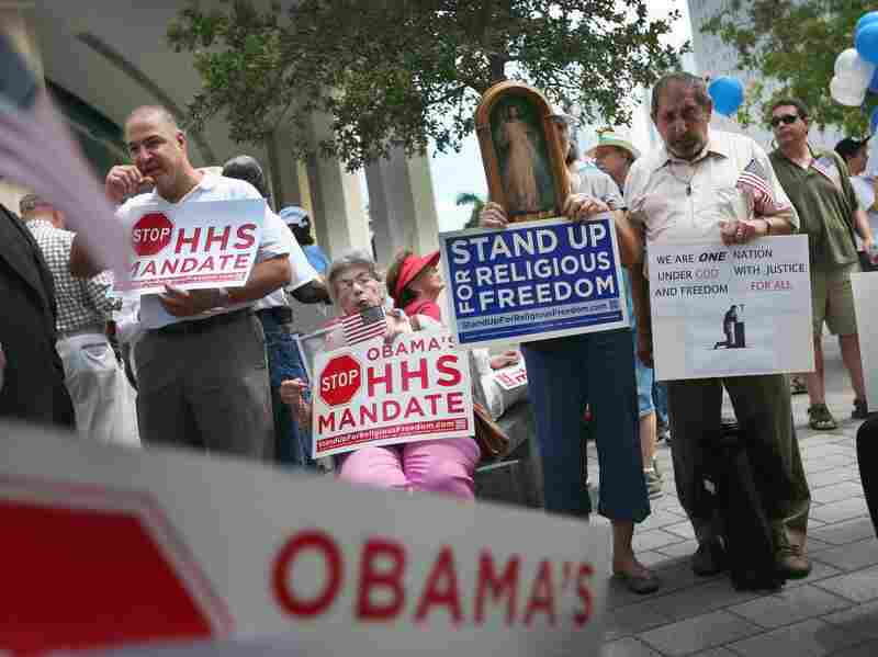 Protesters attend the, 'Stand Up for Religious Freedom Rally' in front of the United States Courthouse on June 8 in Miami, Fla. The Affordable Care Act has drawn criticism not only for its costs, but also for a mandate that would require insurance companies of religious institutions to cover contraceptives for employees.