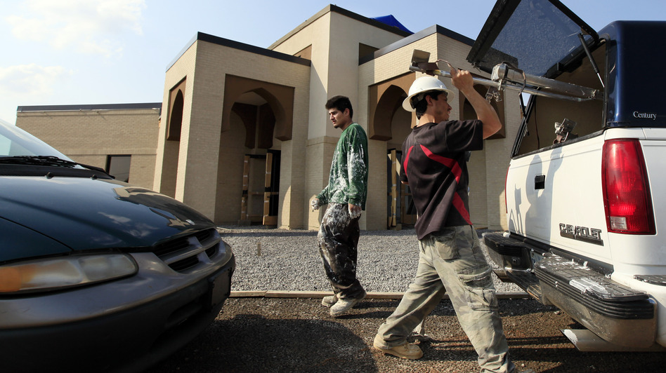 Construction workers pack up at the end of their workday at the Islamic Center in Murfreesboro, Tenn.