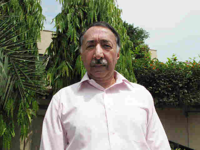 "Retired senior police investigator Zafar Qureshi, 59, stands outside his home in Lahore, Pakistan, where security guards are stationed 24 hours a day. The former police official has probed some of the highest profile cases of official misconduct in Pakistan, and says he fears for his safety and that of his children in a country that he says is steeped in a ""culture of corruption."""