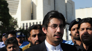 Arsalan Iftikhar Chaudhry (center), son of Pakistan's Supreme Court Chief Justice Iftikhar Muhammad Chaudhry, leaves the Supreme Court after attending a hearing. He is facing allegations of accepting bribes from a powerful property developer totaling some $4 million.