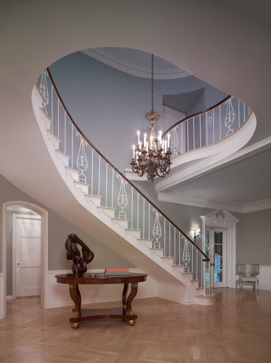 "The staircase of the French Normandy-style Sensenbrenner residence, built in Beverly Hills in 1933, features a Williams trademark cherished by his homes' owners: a beautiful, sinuously curving staircase that was the focal point of the foyer. ""He did the most beautiful entry halls I've ever seen,"" said real estate agent Bret Parsons. (Copyright Benny Chan)"