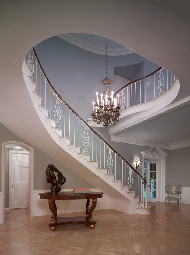 """The staircase of the French Normandy-style Sensenbrenner residence, built in Beverly Hills in 1933, features a Williams trademark cherished by his homes' owners: a beautiful, sinuously curving staircase that was the focal point of the foyer. """"He did the most beautiful entry halls I've ever seen,"""" said real estate agent Bret Parsons."""