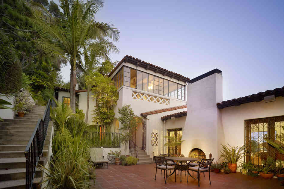 "Williams was a great believer that the mild Southern California climate should be taken advantage of whenever possible. He created an ""outdoor living room"" on the patio of this home, with a fireplace and furniture that would encourage alfresco meals. The large patio doors also help diminish the demarcation between outdoors and indoors."
