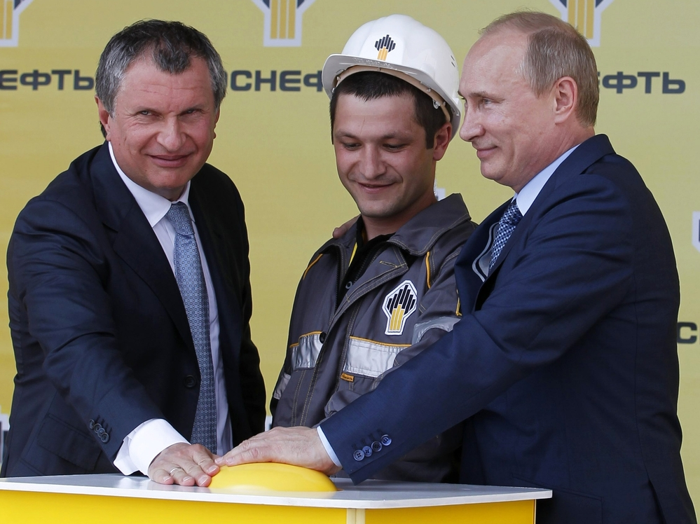 Russia's President Vladimir Putin (R) and CEO of state-controlled Russian oil company Rosneft Igor Sechin (L) push the button launching a new oil terminal at the Black Sea port of Tuapse on June 15. An expected fall in crude prices this autumn could have serious impacts on the economies of Russia and other nations reliant on oil exports.