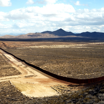 This photograph is included in an exhibition currently at the San Francisco Museum of Modern Art, Photography In Mexico. (Border fence, near Naco, Ariz., 2010)