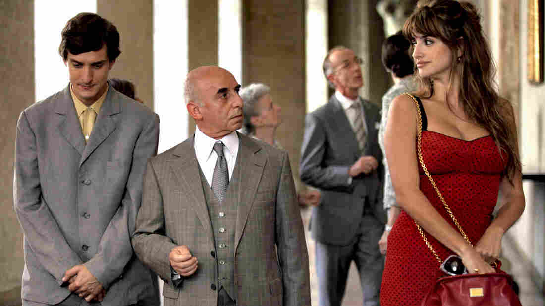 Antonio the newlywed (Alessandro Tiberi, left), Uncle Paolo (Roberto Della Casa) and Anna the prostitute (Penelope Cruz) in one of To Rome With Love's four independent stories. This one features Anna attempting to teach Antonio something about love.