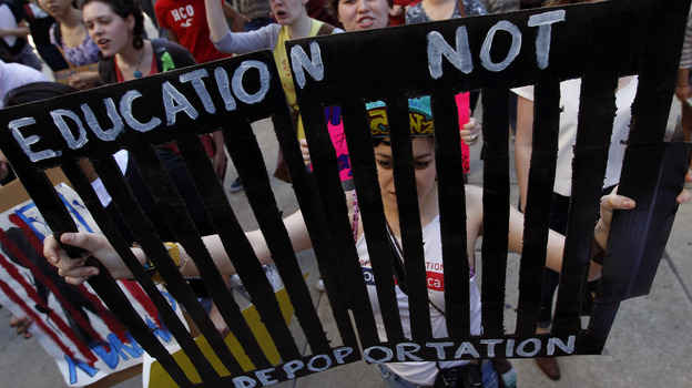 Jovanna Hernandez carries a sign in support of young illegal immigrants during a protest march, which concluded in front of the U.S. Immigration and Customs Enforcement office in Philadelphia in March. (AP)