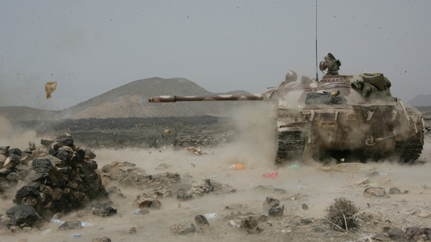 A Yemeni army tank fires at positions of al-Qaida militants near the coastal town of Shaqra, Yemen, last week, in a photo provided by Yemen's Defense Ministry. Yemen's army says it has pushed al-Qaida fighters out of towns in the south. (AP)