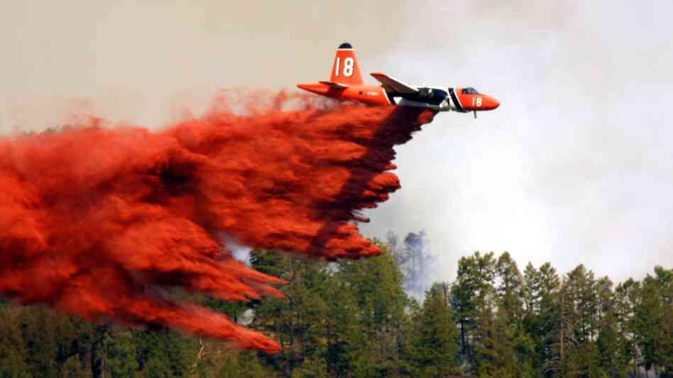 A plane drops fire retardant in LaPlata County, near Durango, Colo.