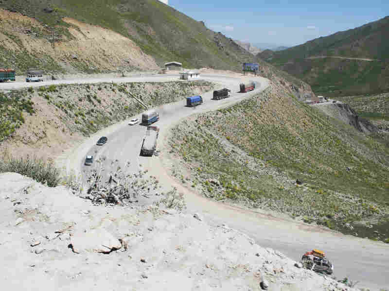Vehicles drive one of the many switchbacks as the Salang Highway climbs from just over 5,000 feet at the valley floor to the Salang Tunnel, 11,000 feet up in the Hindu Kush range.