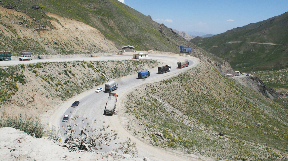Vehicles drive one of the many switchbacks as the Salang Highway climbs from just over 5,000 feet at the valley floor to the Salang Tunnel, 11,000 feet up in the Hindu Kush range. (NPR)