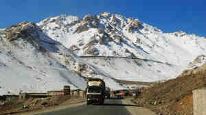 A truck drives down a highway on Salang Pass in Afghanistan's Parwan province in December. The Salang Tunnel, which crosses under the pass, provides a vital link between Central Asia and northern Afghanistan to Kabul.