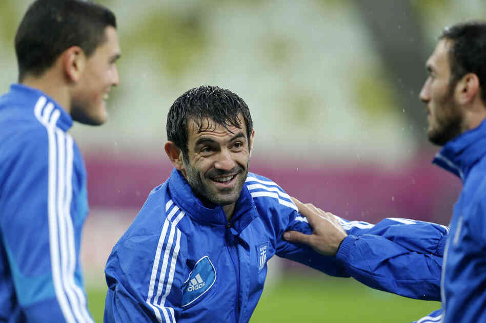 Greece's captain Giorgos Karagounis chats with his teammates during a training session, prior to the Euro 2012 soccer quarterfinal match between Germany and Greece in Poland.