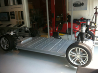 The liquid-cooled battery of the Model S sits on top of the car's body structure, beneath the passenger compartment. The car's three radiators help keep the cabin — and the battery — comfortable.