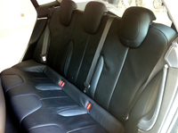The sedan's rear seats go three wide. With the seats folded flat, the car offers some 66 cubic feet of storage, according to Tesla.