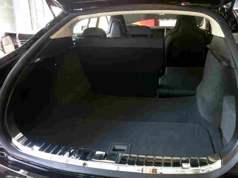 The Rear Trunk Of Model S Sedan Includes A Removable Panel In Foreground