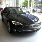 The new Model S from Tesla has a maximum range of 265 miles with a full charge. The car can also reach 60 miles per hour in 4.4 seconds — a feat the company says may affect overall mileage.