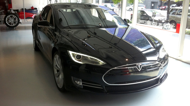 The new Model S from Tesla has a maximum range of 265 miles with a full charge. The car can also reach 60 miles per hour in 4.4 seconds — a feat the company says may affect overall mileage. (NPR)