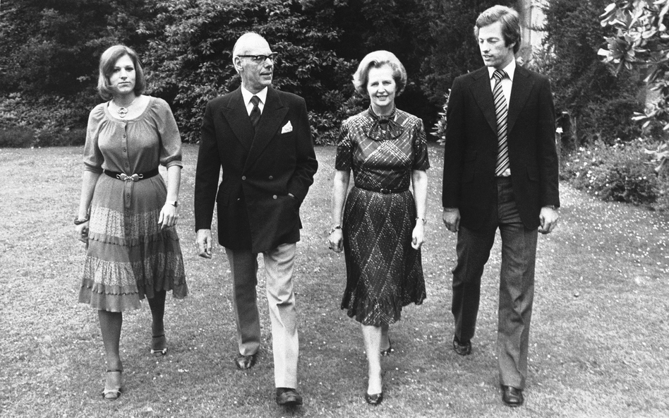 Thatcher strolls through the grounds of Scotney Castle in Kent, England, where she was a tenant of a National Trust flat. With her in this March 1979 photograph are her husband, Denis, and their twins, Mark and Carol. (AP)