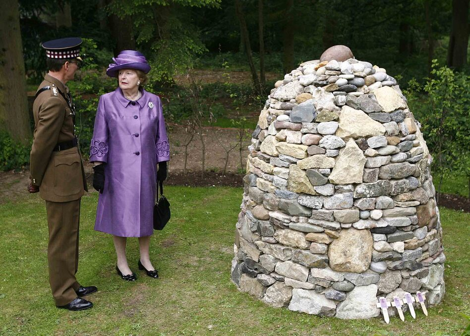 Thatcher stands by a memorial cairn built from 255 stones (one stone for each British serviceman killed) that were brought from the Falkland Islands as part of commemorations of the 25th anniversary of the end of the conflict, at the Falkland Islands Memorial Chapel in Pangbourne, England, June 14, 2007. (AP)