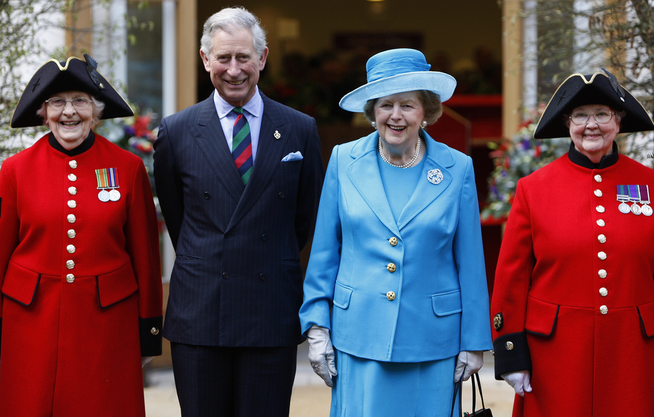 Britain's Prince Charles and Margaret Thatcher are joined by the first female Chelsea pensioners, Dorothy Hughes (left) and Winifred Phillips, as they attend the opening of the new Margaret Thatcher Infirmary at London's Royal Hospital Chelsea, March 25, 2009. (AP)