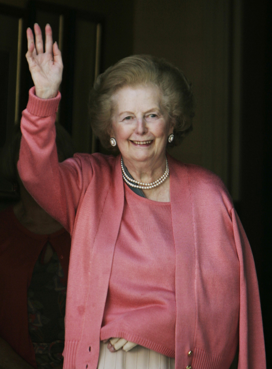 Thatcher waves to members of the media as she stands on her doorstep in London, following her return home from the hospital, June 29, 2009. Thatcher, suffering from dementia, had fallen and broken her left arm. (AP)