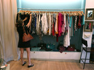 Vanessa Loren shops in Miami. An index of consumer sentiment dropped more than expected in June.