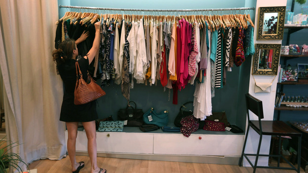 Vanessa Loren shops in Miami. An index of consumer sentiment dropped more than expected in June. (Getty Images)