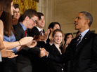 President Barack Obama shakes hands with students after urging Congress to pass legislation that would keep federal student loan rates from doubling in the East Room of the White House June 21 in Washington, D.C.