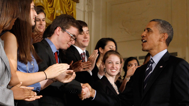 President Barack Obama shakes hands with students after urging Congress to pass legislation that would keep federal student loan rates from doubling in the East Room of the White House June 21 in Washington, D.C. (Getty Images)