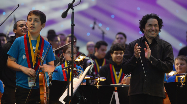 Gustavo Dudamel applauds the youngsters of Scotland's Big Noise Orchestra after their Thursday performance in Stirling. (Getty Images)