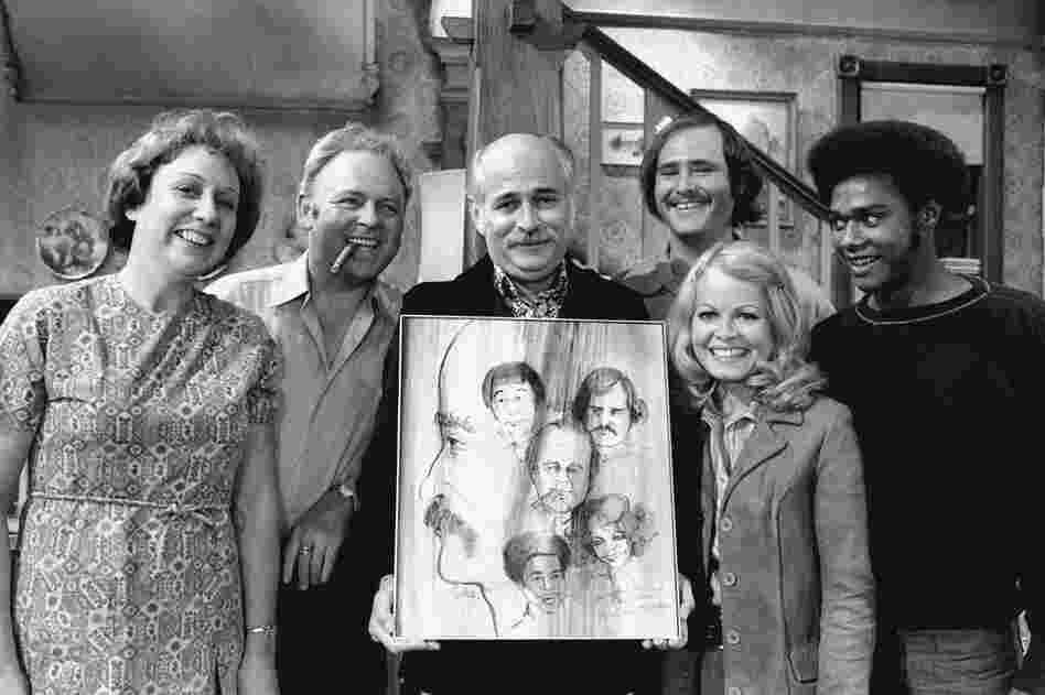 Norman Lear (center) created, developed and produced the hit show All in the Family, which ran from 1971 to 1979. The politically charged sitcom starred Jean Stapleton, Carroll O'Connor, Rob Reiner, Sally Struthers and Mike Evans.