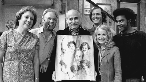 Norman Lear (center) created, developed and produced the hit show All in the Family, which ran from 1971 to 1979. The politically charged sitcom starred Jean Stapleton, Carroll O'Connor, Rob Reiner, Sally Struthers and Mike Evans. (CBS /Landov)