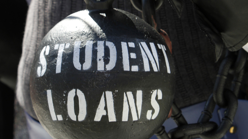 A demonstrator holds a ball and chain representing his college loan debt during an Occupy D.C. protest in Washington in October.
