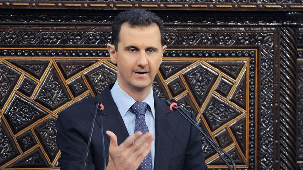 President Bashar Assad addresses Parliament on June 3. Syrians in the capital, Damascus, have become more willing to speak out, though they still don't want to be identified by name. Many feel the Assad regime is losing control of parts of the country. (SANA/AP)