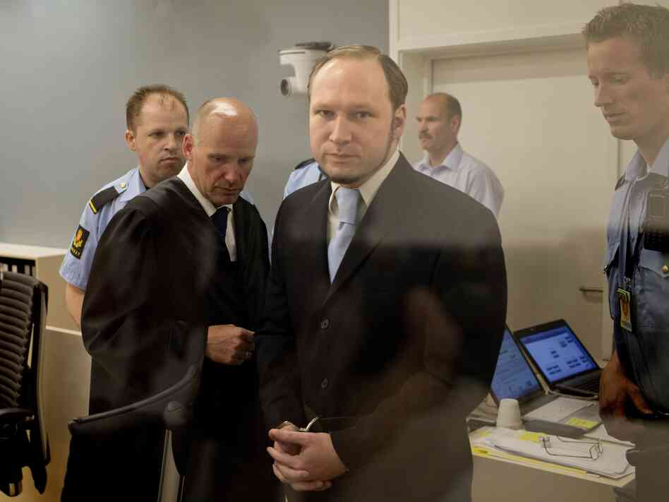In this picture taken through bullet proof glass, mass killer Anders Behring Breivik looks on as he arrives for his trial in room 250 of Oslo's central court on June 21, 20