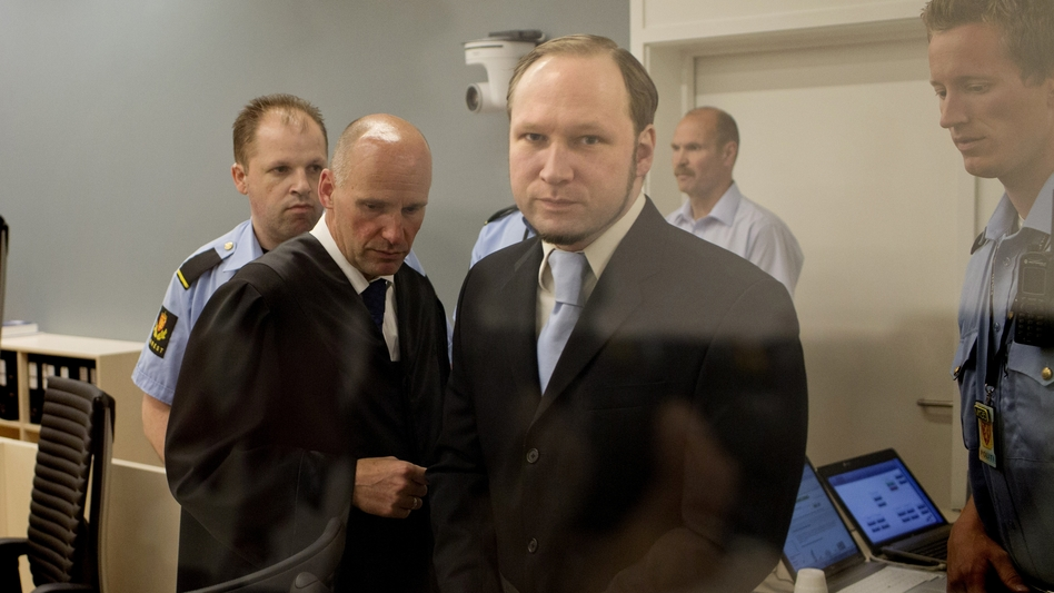 In this picture taken through bullet proof glass, mass killer Anders Behring Breivik looks on as he arrives for his trial in room 250 of Oslo's central court on June 21, 2012. (AFP/Getty Images)