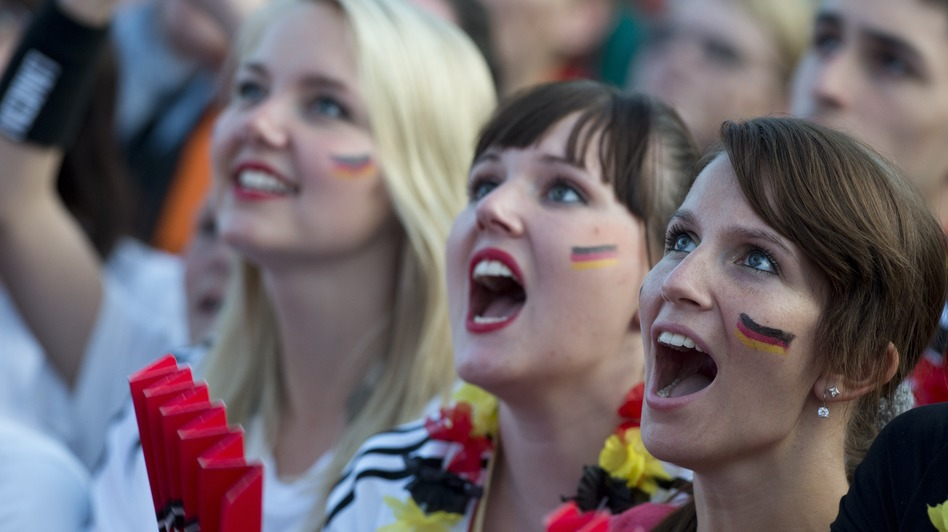 German soccer fans in Berlin cheer on their team June 17 at a public screening of the game against Denmark, which Germany won, 2-1. (AFP/Getty Images)