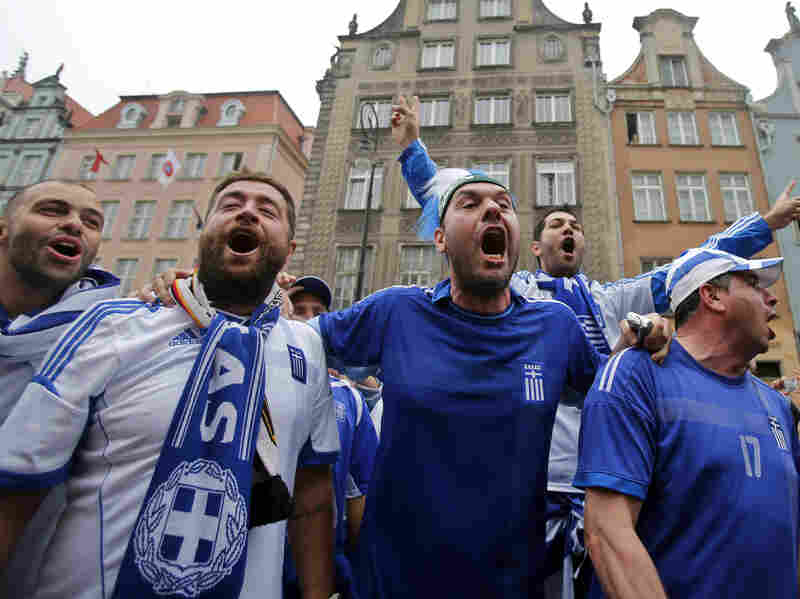 Greek fans shout slogans before Friday's soccer match between Greece and Germany in Gdansk, Poland.