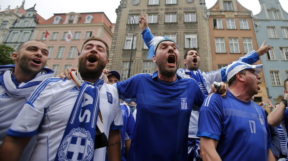 Greek fans shout slogans before Friday's soccer match between Greece and Germany in Gdansk, Poland. (AP)