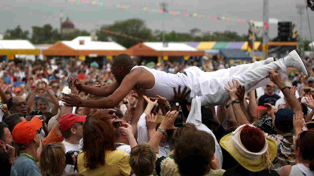 Glen David Andrews, the New Orleans trombonist and singer and regular on HBO's Treme, surfs the crowd at the 2010 New Orleans Jazz & Heritage Festival.