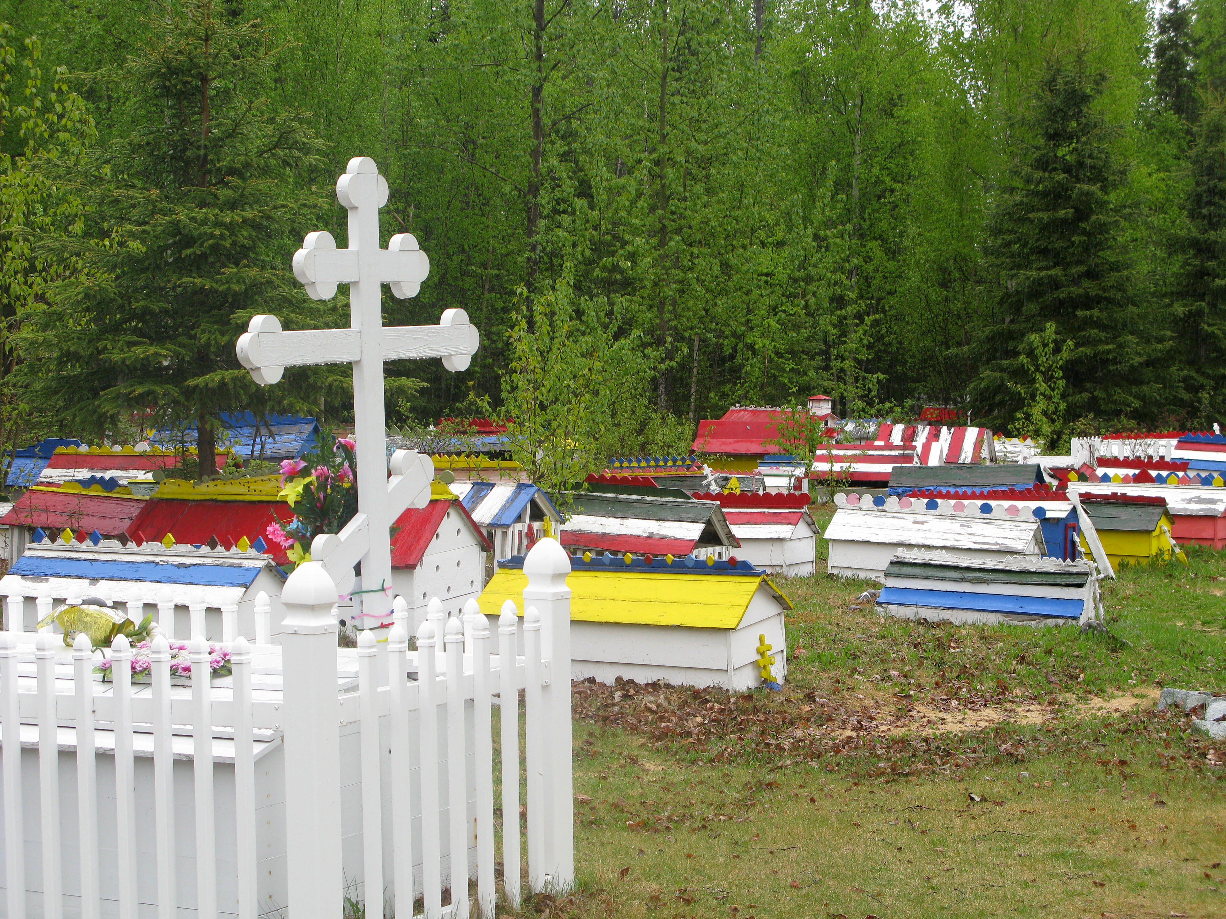A plot in the Eklutna Cemetery features a traditional three-barred Russian Orthodox cross.