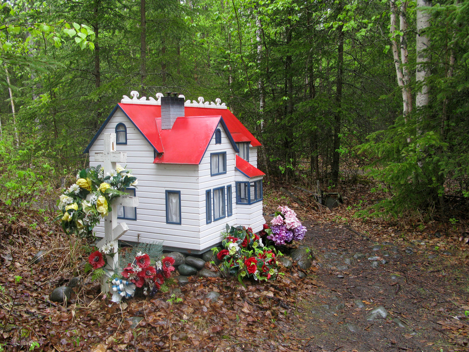 The spirit house for Marie Rosenberg, who died in 2003, was built to resemble the girl's dormitory at the Eklutna Vocational School. (Diana Derby)