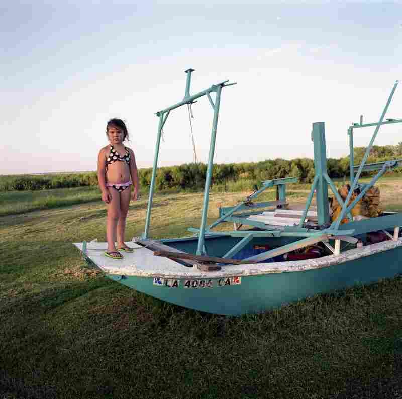 Kierstin Guidry with Hilton Chaisson's Boat, Isle de Jean Charles, Louisiana, 2010