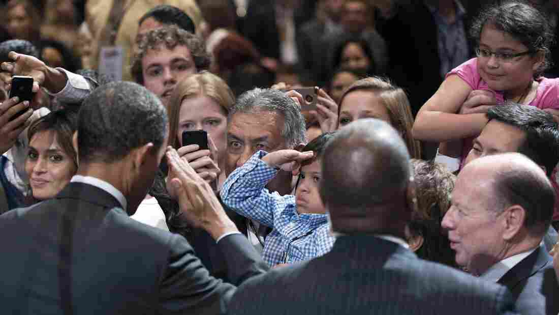 President Obama returned a young fan's salute at the conference of the National Association of Latino Elected Officials in Orlando, Fla.